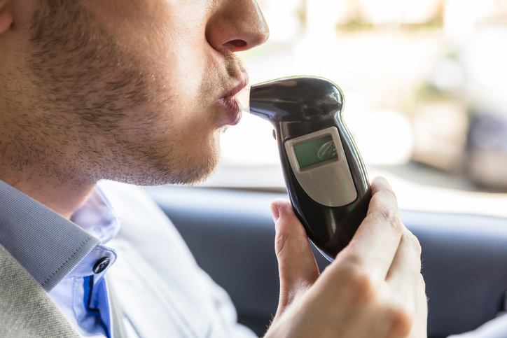driver blowing into breath test