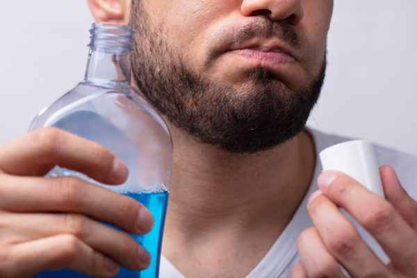 Close-up Of A Man Rinsing His Mouth With Mouthwash