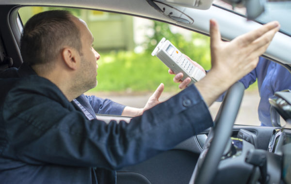 Driver being subject to test for alcohol content with use of breathalyzer